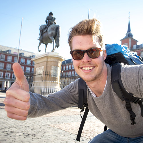 Backpacking Tourist giving Thumbs Up